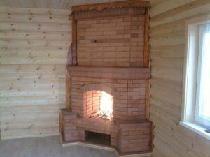 Угловой дровяной камин из кирпича
