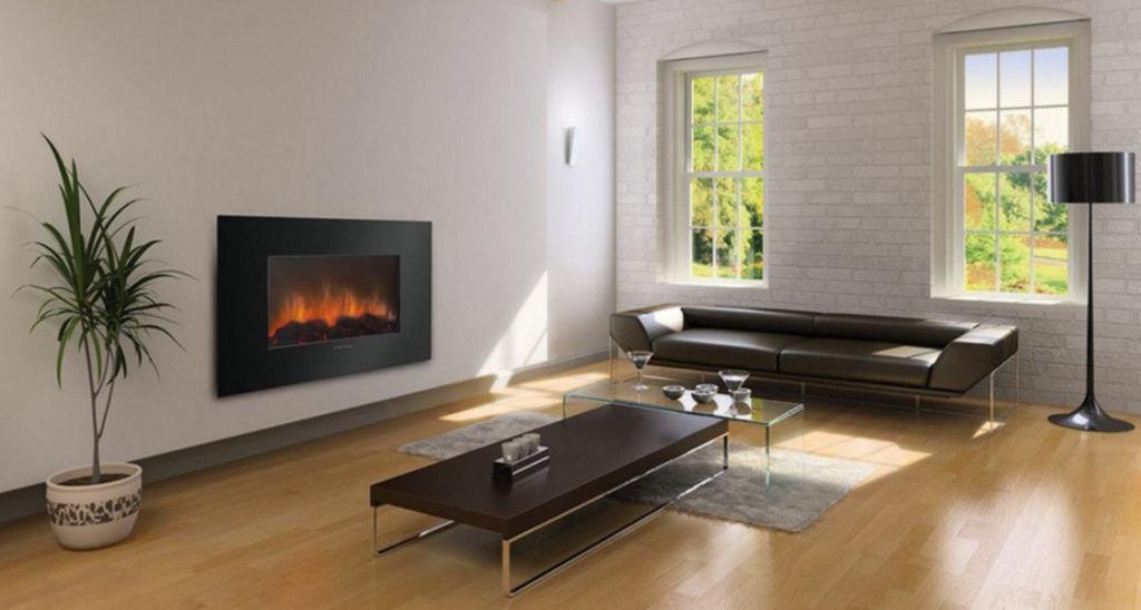 Встроенный электрокамин в стену выглядит очень эстетично и делает комнату уютнее