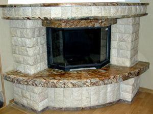 Облицовка портала углового камина плиткой и искуственным камнем
