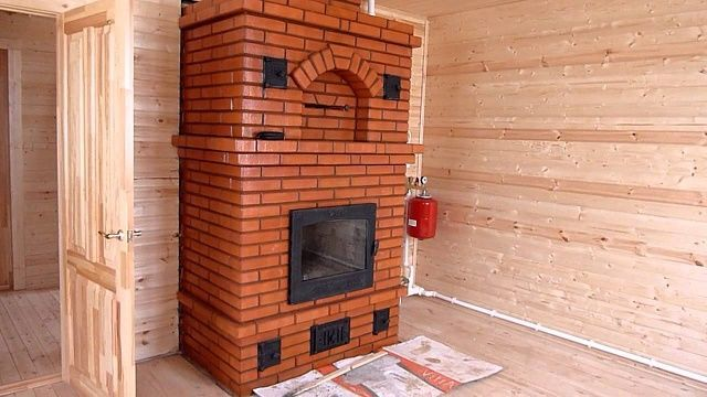 Каменная печь-камин с встроенным теплообменником